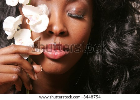 Beautiful sexy black woman with orchid - stock photo