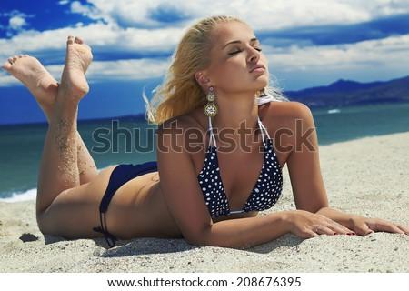 beautiful sexy blond woman on the beach. beauty girl in bikini. summer holidays.Blue Sea.nature background - stock photo