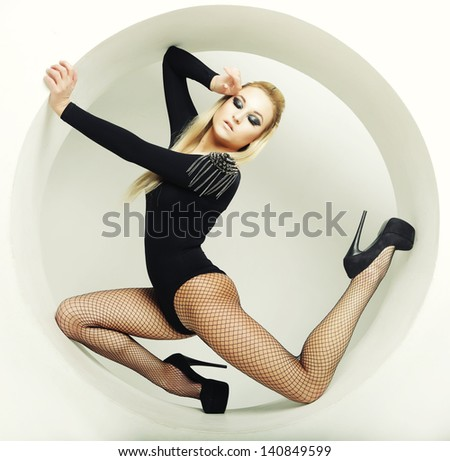 beautiful sexy blond woman posing in circle - stock photo