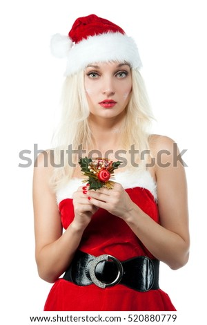Beautiful sexy blonde girl in Christmas costumes posing on a white background isolated