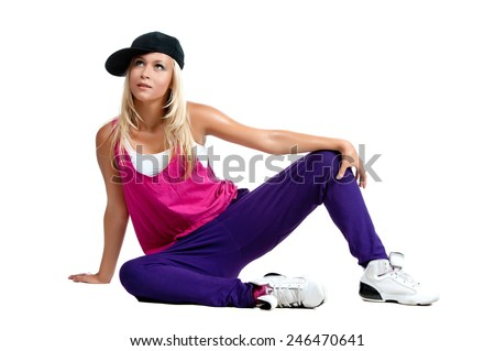 Beautiful sexy blonde girl in sports clothes, posing on a white background isolated