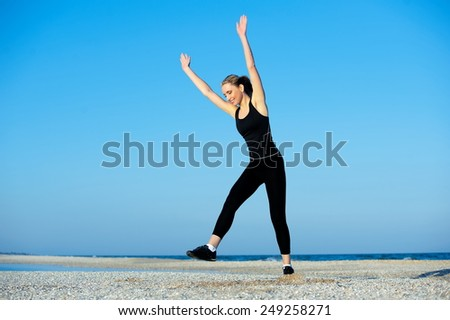 Beautiful sexy blonde girl playing sports on the beach - stock photo