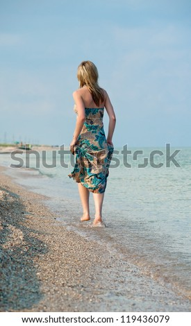 Beautiful sexy blonde girl running on the beach