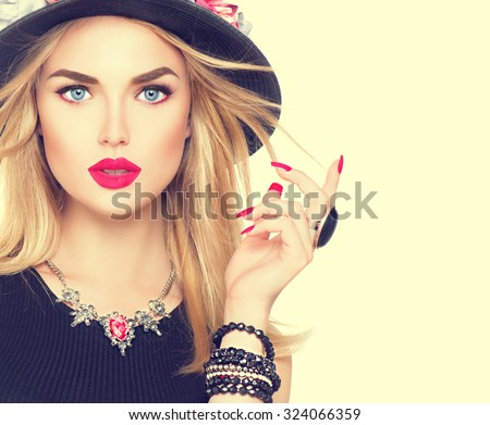 Beautiful sexy blonde woman with red lips and manicure in modern black hat. Beauty fashion model girl portrait with accessories- bracelets, necklace and elegant hat - stock photo