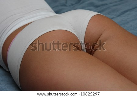 Beautiful sexy bottom in shorts - stock photo