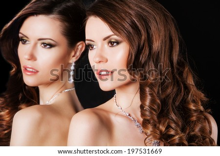 beautiful sexy brunette girl female model with bright makeup and luxury accessories and her reflection in mirror table - stock photo
