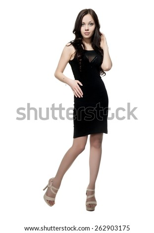 Beautiful sexy brunette girl in black dress posing on a white background isolated - stock photo