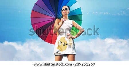 Beautiful sexy brunette holding colorful umbrella