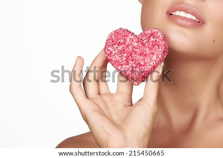 Beautiful sexy brunette woman eating sweet cake on a white background, healthy food, tasty food, organic