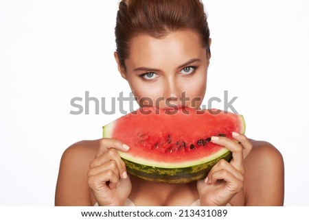 Beautiful sexy brunette woman eating watermelon on a white background, healthy food, tasty food, organic