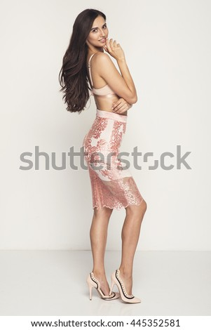Beautiful sexy brunette woman, perfect body, nice hair style, nude bra, lace skirt - stock photo