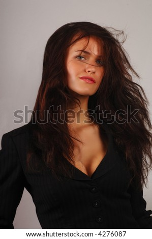 Beautiful sexy Business woman in suit on grey - stock photo