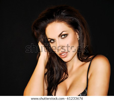 beautiful sexy Caucasian woman  in lingerie on black background - stock photo