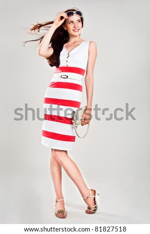 Beautiful sexy caucasian woman in stylish dress. Studio shot