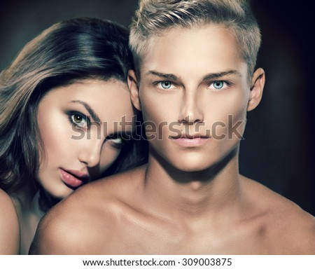 Beautiful sexy couple portrait. Model man with his girlfriend posing together. Passion. Boy and Girl in love - stock photo