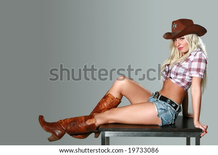 Beautiful sexy Cowgirl in cowboy hat - stock photo