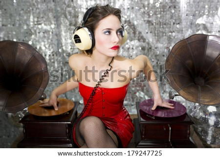 beautiful sexy disco dj in red dress with gramophones. Perfect for stylish club, disco and fashion events  - stock photo