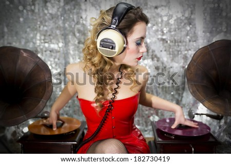 beautiful sexy disco dj in red dress with gramophones. Perfect for stylish club, disco and fashion events