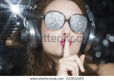 beautiful sexy disco woman, listening to music with sparkle covered sunglasses. Perfect for stylish club, disco and fashion events