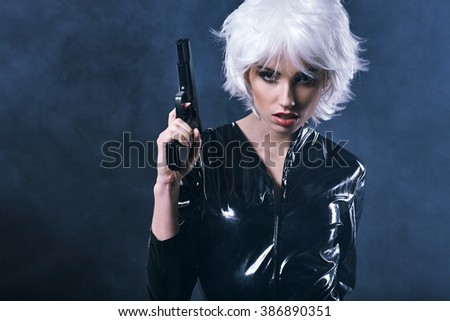 beautiful sexy girl holding gun . smoke background - stock photo
