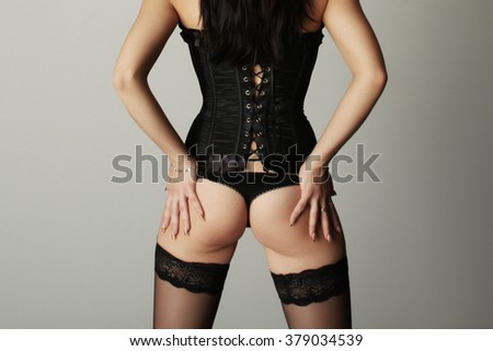 beautiful sexy girl in a corset in a photo studio