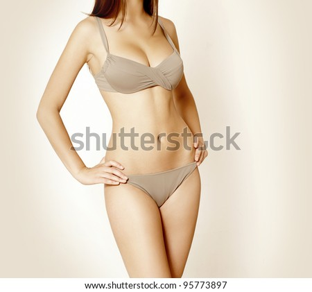 Beautiful sexy girl in bikini - stock photo