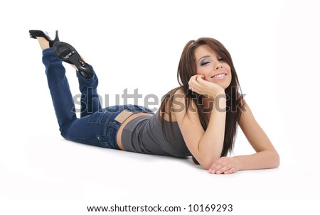Beautiful sexy girl in jeans Smiling and Relaxing - stock photo
