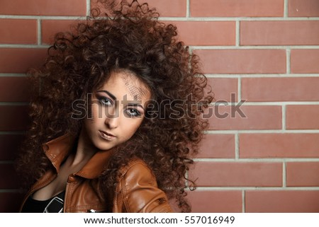 beautiful sexy girl on background of brick wall