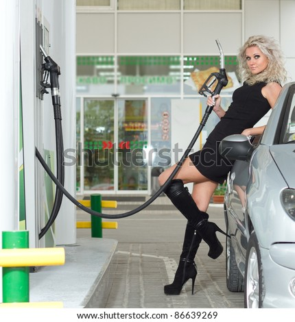 Beautiful sexy girl on fuel station