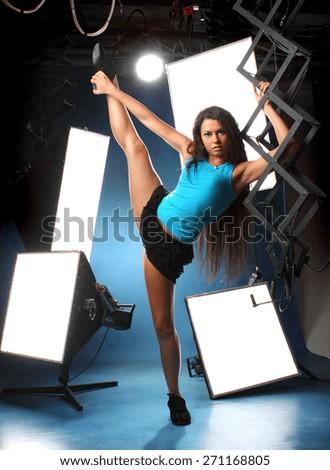 beautiful sexy girl on studio equipment . long beautiful hair. vivid emotions .  acrobatic posture  - stock photo