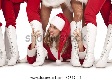 Beautiful sexy girl wearing santa claus clothes having party with her friends Santa Claus - stock photo