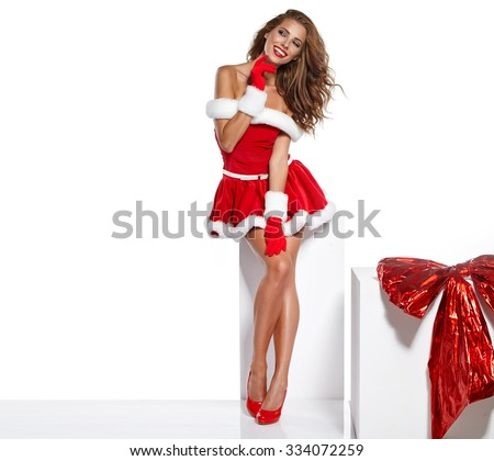 beautiful sexy girl wearing santa claus clothes isolated on white - stock photo