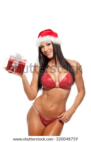 beautiful sexy girl wearing santa claus clothes with christmas gift. - stock photo