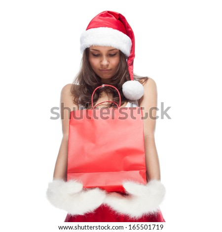 Beautiful sexy girl wearing santa claus clothes with paper gift bags in hands