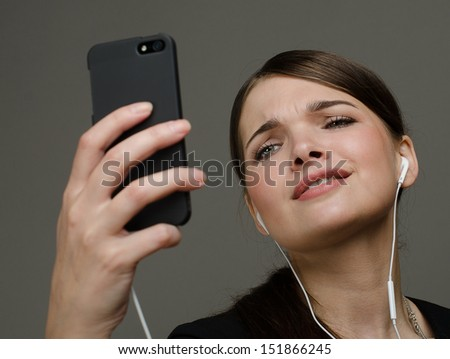 Beautiful sexy girl with a telephone and headphones - stock photo