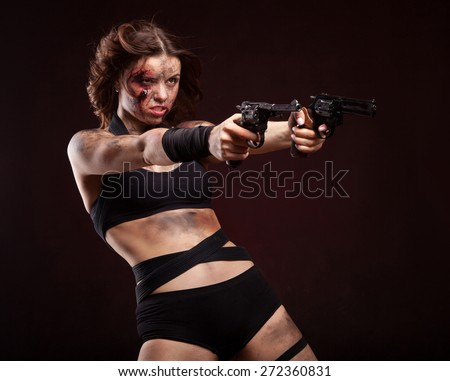 Beautiful sexy girl with gun. Posing in studio. With blood on face and wound.