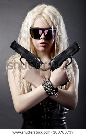 Beautiful sexy girl with guns isolated on black background - stock photo