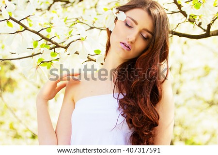 Beautiful sexy girl with long hair. Spring.