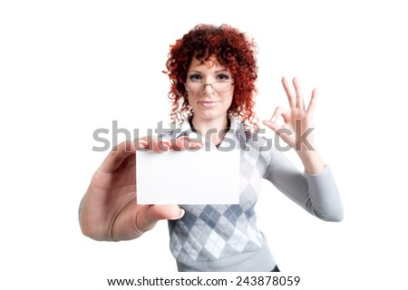 Beautiful sexy girl with red hair in office clothes posing in the studio on a white background, isolated