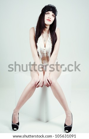 beautiful sexy girls dressed in white underwear with a bandage for sleeping. She poses in the studio on a white background. - stock photo