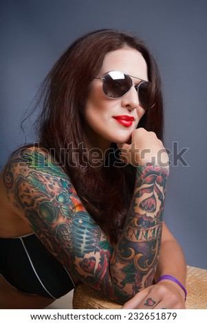 Beautiful sexy glamorous girl with tattoos.red. - stock photo
