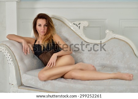 Beautiful sexy lady in elegant black bodysuit. Portrait of fashion model girl indoors. Beauty brunette woman with attractive buttocks in lace lingerie. Female ass in underwear. Naked body - stock photo