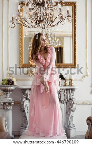 Beautiful sexy lady in elegant pink robe. Close up fashion portrait of model indoors. Beauty blonde woman with attractive body in lace lingerie. Female ass in underwear. Closeup naked girl