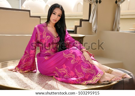 Beautiful sexy lady in pink oriental dress