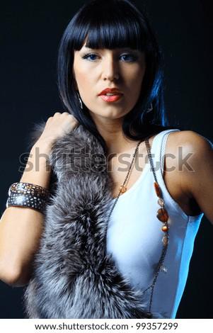 Beautiful sexy lady on dark background. Studio shot - stock photo