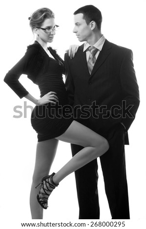 Beautiful sexy lady seducing young businessman isolated on white.
