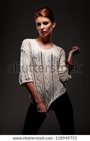 beautiful sexy model posing over dark background - stock photo