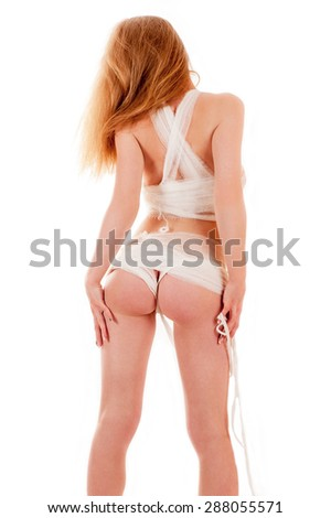 beautiful sexy nude woman standing back in bandages - stock photo