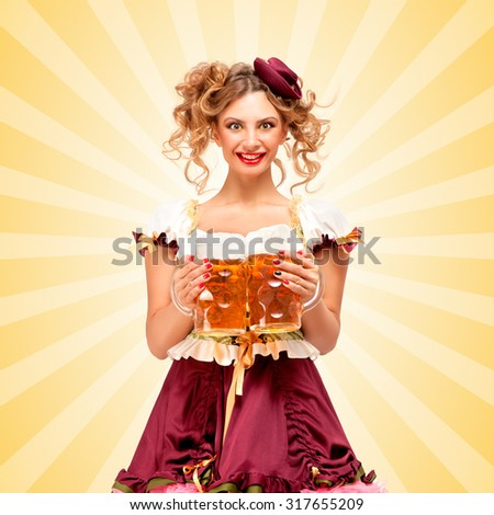 Beautiful sexy Oktoberfest waitress, wearing a traditional Bavarian dress dirndl, serving two big beer mugs in a tavern and smiling on colorful abstract cartoon style background.