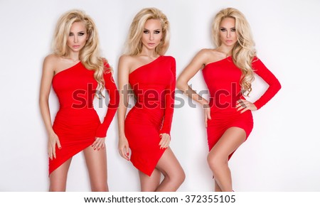 BEAUTIFUL SEXY shapely three blonde with long hair slender legs and AMAZING EYE, The RED DRESS Valentine's tempting short asymmetrical standing on a white background and sensually looks at the camera